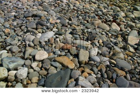 Granite Pebbles, Rounded By The Ocean.