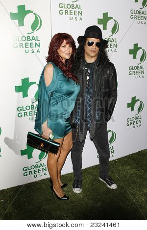 LOS ANGELES - MAR 3: Slash and Perla Ferrar at the Global Green USA 7th Annual Pre-Oscar Party 'Greener Cities for a cooler Planet at Avalon in Los Angeles, California on March 3, 2010