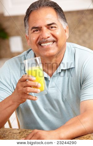 Senior man drinking orange juice