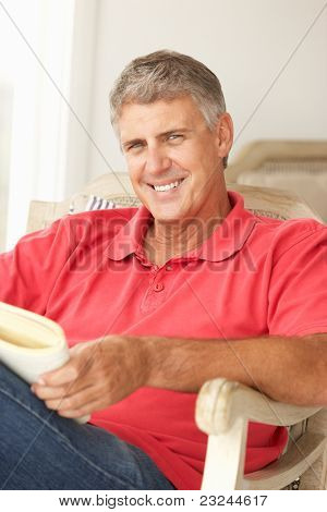 Mid age man reading a book