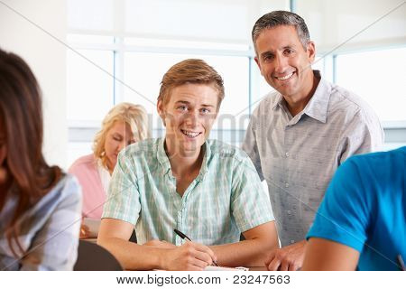 Tutor helping student in class