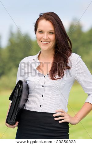 Businesswoman In Sunny Nature Smiling Briefcase