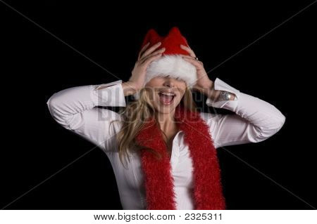 Girl In A Santa Hat And Boa Having Fun