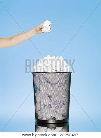 Trowing A Paper Into A Wastebasket