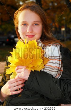 Girl With Fall Leaves