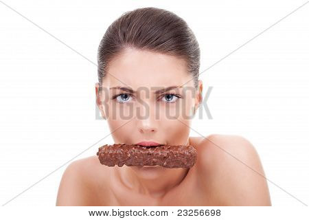 Serious Woman Eating Chocolate Bar