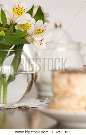 Delicate Flower In Glass Vase On Wooden Table