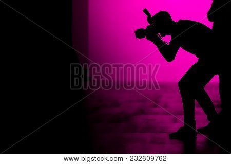 A Silhouette Of A Photographer