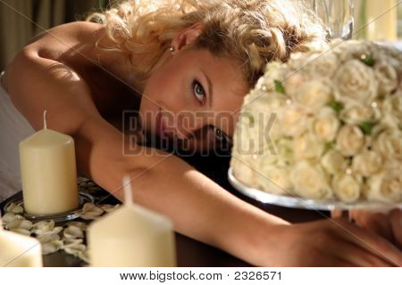Bride With Bouquet And Candles