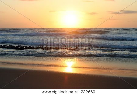 Sunrise Through Waves