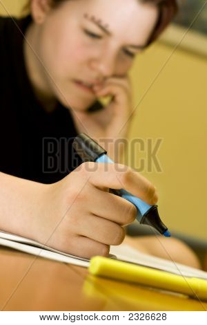 Student Girl Biting Nails While Studying