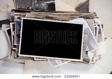 Stack of old photos with one blank photo for your image.
