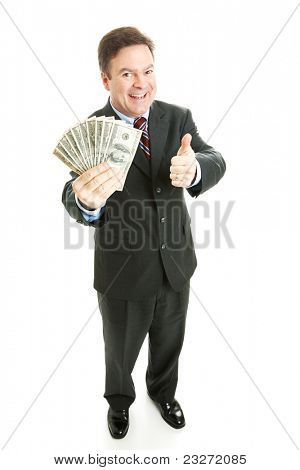 Successful businesman holding a wad of cash in hundred dollar bills.  Full body isolated on white.