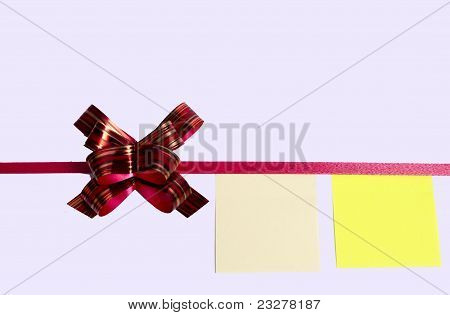 Red Bow On White Paper Listed