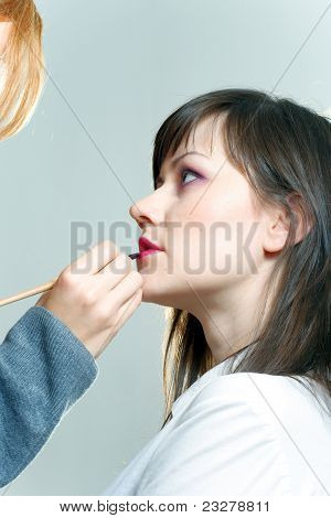 Beautiful model woman is getting prepared for photo shoot