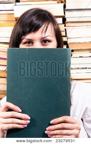 Student Girl Hiding Behind Big Book