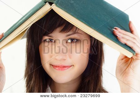 Young University Student With A Book On Her Her Against White Is