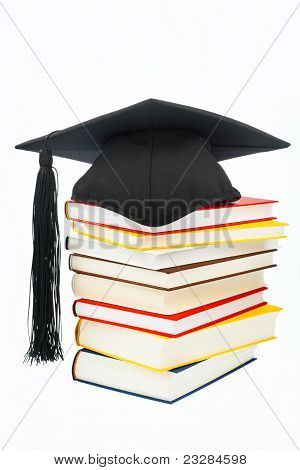Mortarboard on a book stack