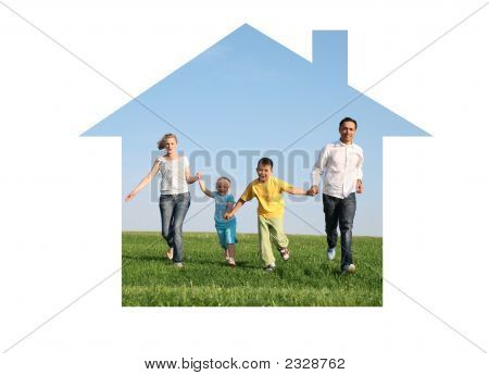 Family Of Four Running In Dream House