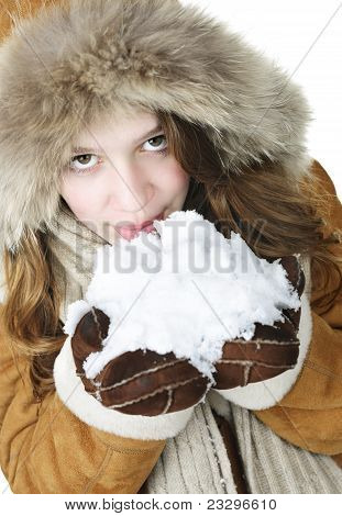 Playful Winter Girl Holding Snow