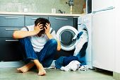 image of kitchen appliance  - Concept Man stressed on the kitchen floor - JPG