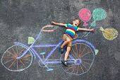 Happy Little Kid Boy Having Fun With Bicycle And Air Balloons Picture Drawing With Colorful Chalks O poster
