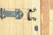 Old Vintage Door Handle. Vintage Iron Handle And Wooden Doors. Wood Doors And Walls Are Different In poster