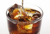 stock photo of coca-cola  - closeup of cola being poured - JPG