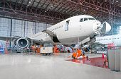 Passenger Airplane On Maintenance Of Engine And Fuselage Repair In Airport Hangar. Aircraft With Ope poster