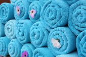 Blue Roll Towels. Clean Fresh Towels With Fresh Flowers Neatly Stacked On Top Of Each Other. Spa. Ma poster