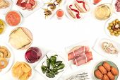 An Overhead Photo Of A Collection Of Spanish Tapas Food, Shot From Above On A White Background, Form poster