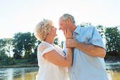 Low-angle side view portrait of a romantic senior couple in love enjoying a healthy and active lifes poster