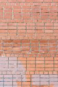 The Wall Of Bricks Is Unglued Dirty Orange. Beautiful Background Of Smooth Masonry. Texture. poster
