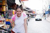 Beautiful Woman Wearing White Shirt Wearing A Water Gun Water Festival In Thailand Young Happy Beaut poster