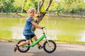 Little Boy On A Bicycle. Caught In Motion, On A Driveway. Preschool Childs First Day On The Bike. T poster