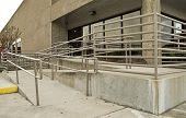 pic of physically handicapped  - The front of a building equipped with a ramp and railings for the physically challenged - JPG