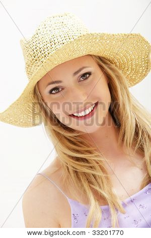 Attractive Young Woman In Straw Hat