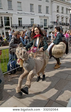 rama students dressed as riders and horses arrive at Exeter Cathedral Green