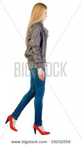 walking blonde girl in motion.  back view of going woman.  during a walk. Rear view people collection.  backside view of person.  Isolated over white background.