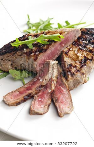 grilled beefsteak pickled in Dijon mustard with ruccola