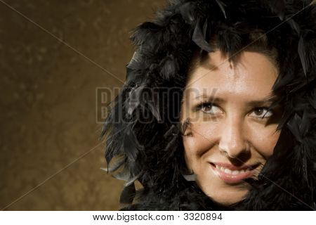Pretty Hispanic Woman Wearing Feathers