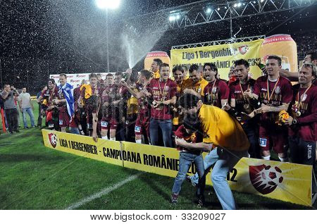 Soccer players celebrating the league title