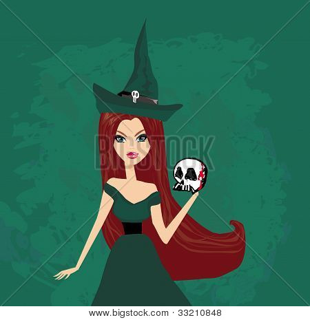 Halloween witch standing with skull