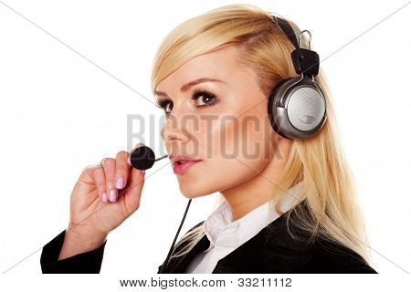 Smart professional blonde woman wearing headphones and speaking into a microphone