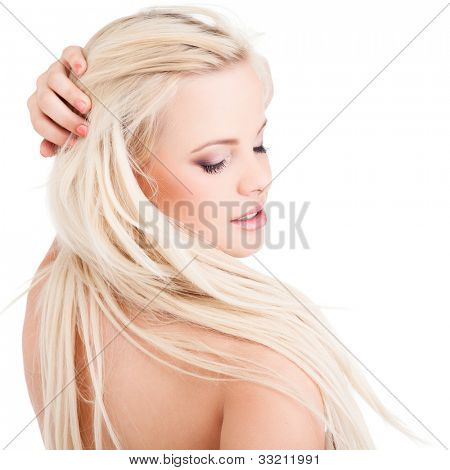 Portrait of a sensual young blond woman isolated on white background