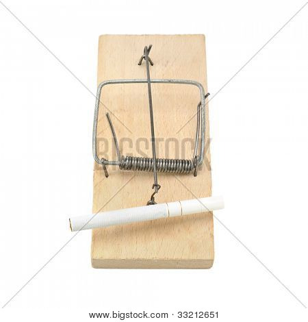 Cigarette in a mousetrap. Concept - the hazards of smoking.