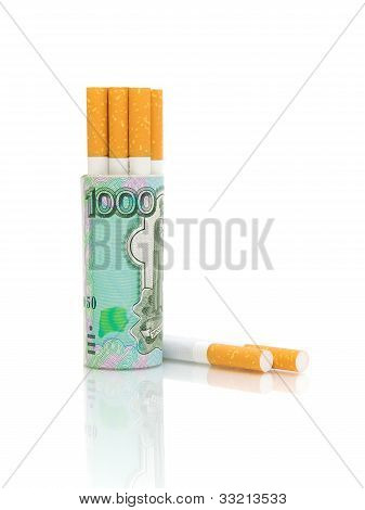 Cigarettes And Banknotes On A White Background