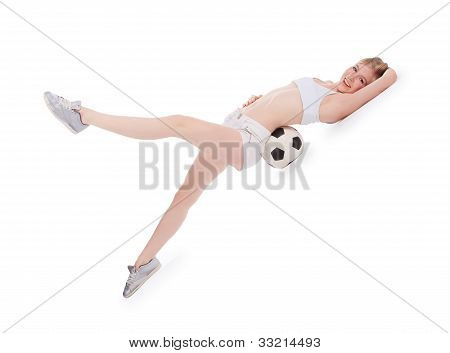 Teenager Lying On The Floor With Soccer Ball Over White