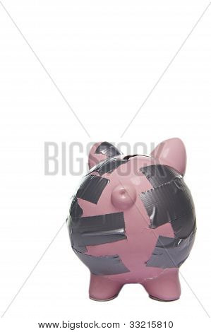 broken piggy bank rear view isolated on white