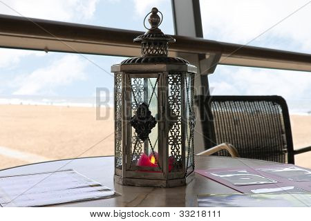 A Candle In A Decorative Candlestick At The Beach Cafe. Den Haag. Netherlands.
